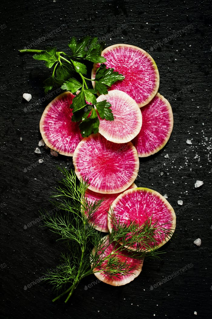 round slices of watermelon pink radish, dill, parsley