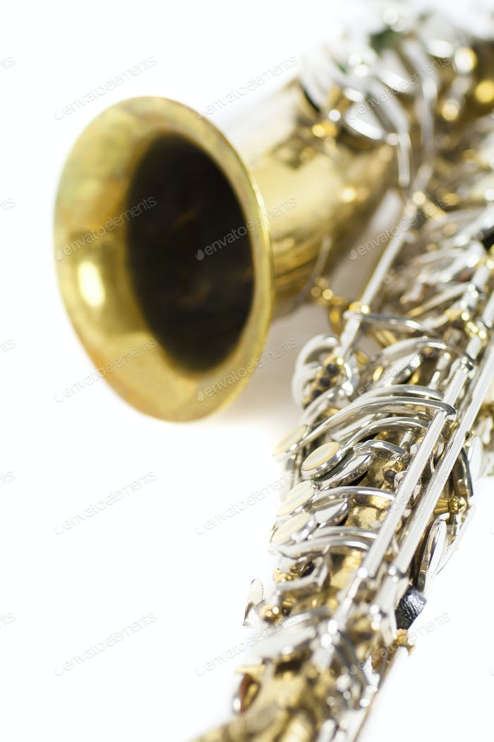 detail of an isolated in white portrait of an alto saxophone