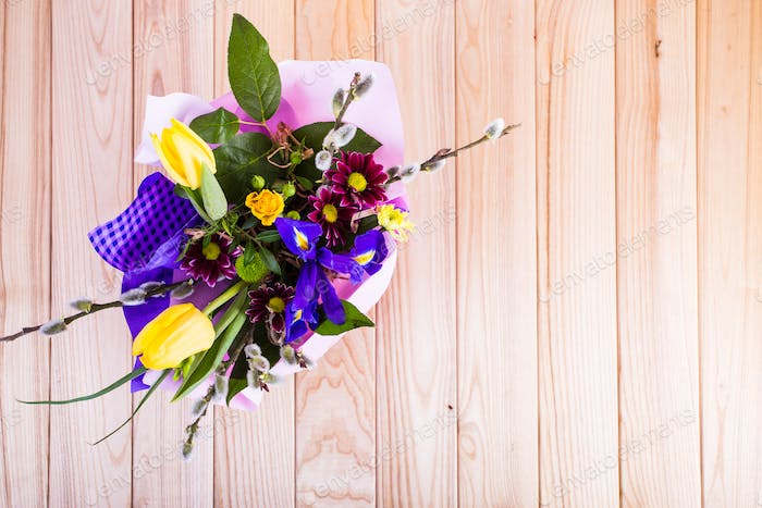Beautiful floral arrangement on wooden background