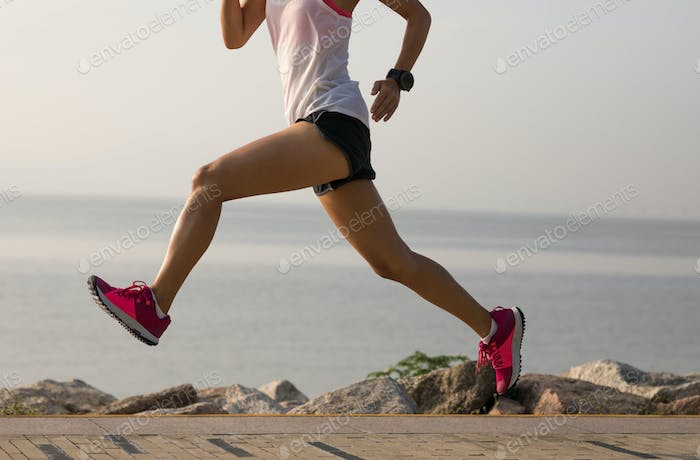 Woman athlete running on seaside
