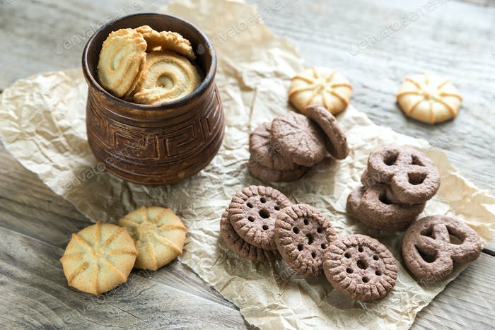 Butter and chocolate chip cookies on the wooden background