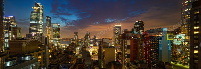 Panoramic view of Manhattan skyscrapers lights, New York city, in the evening