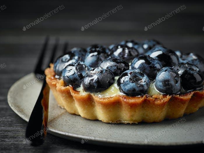 close up of blueberry tart