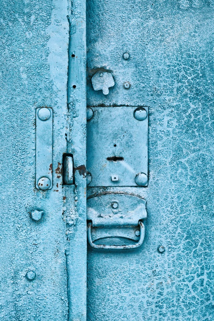 Close up of padlock and old metal hasp and staple on an vintage door