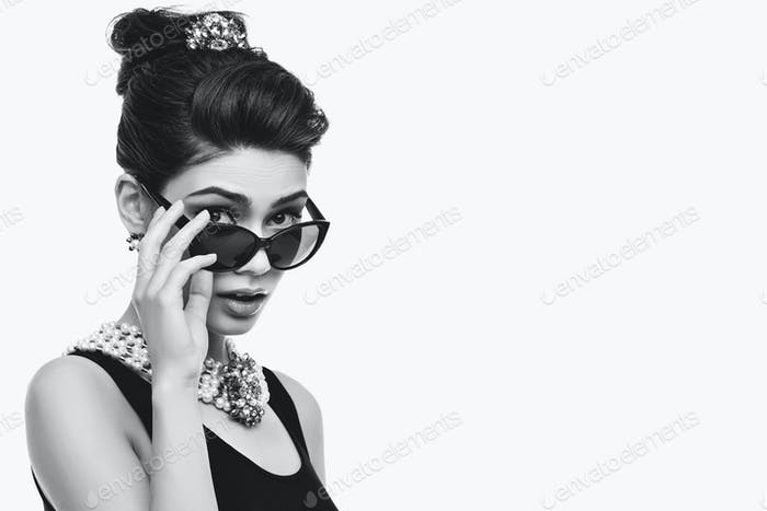 beautiful young woman in retro style with croissant