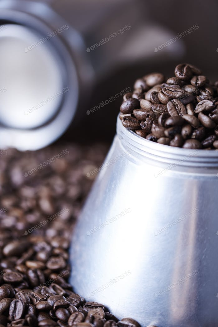 Defocused coffee grinder among coffee beans