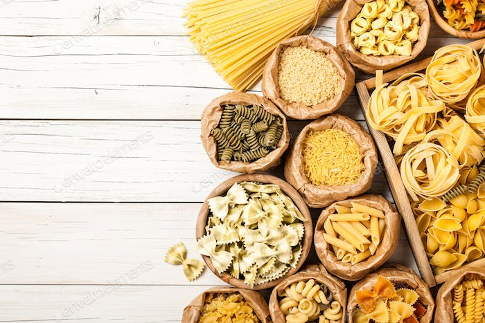 Assortment of pasta on a wooden table