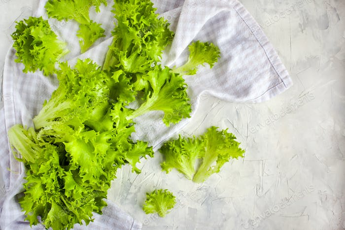 Fresh raw green frillice iceberg lettuce salad on table, top vie