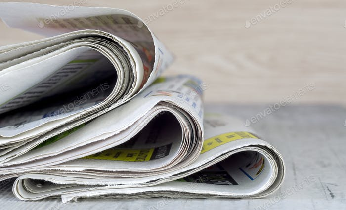 A Small Pile of Newspapers