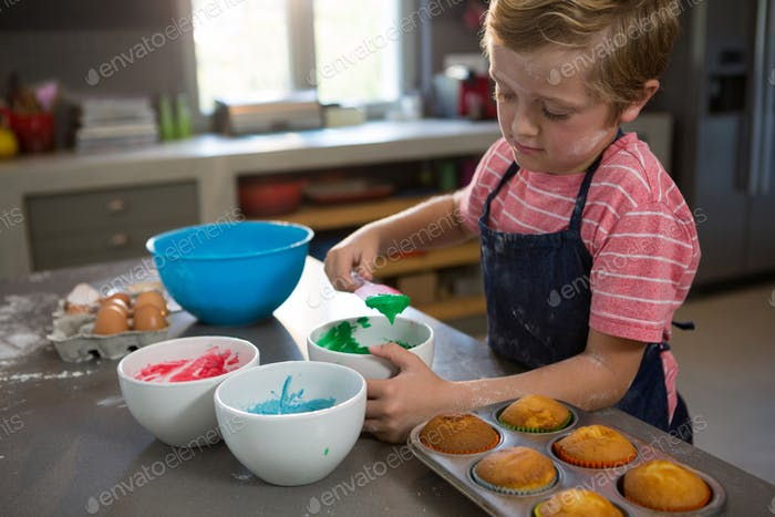 Boy mixing green batter