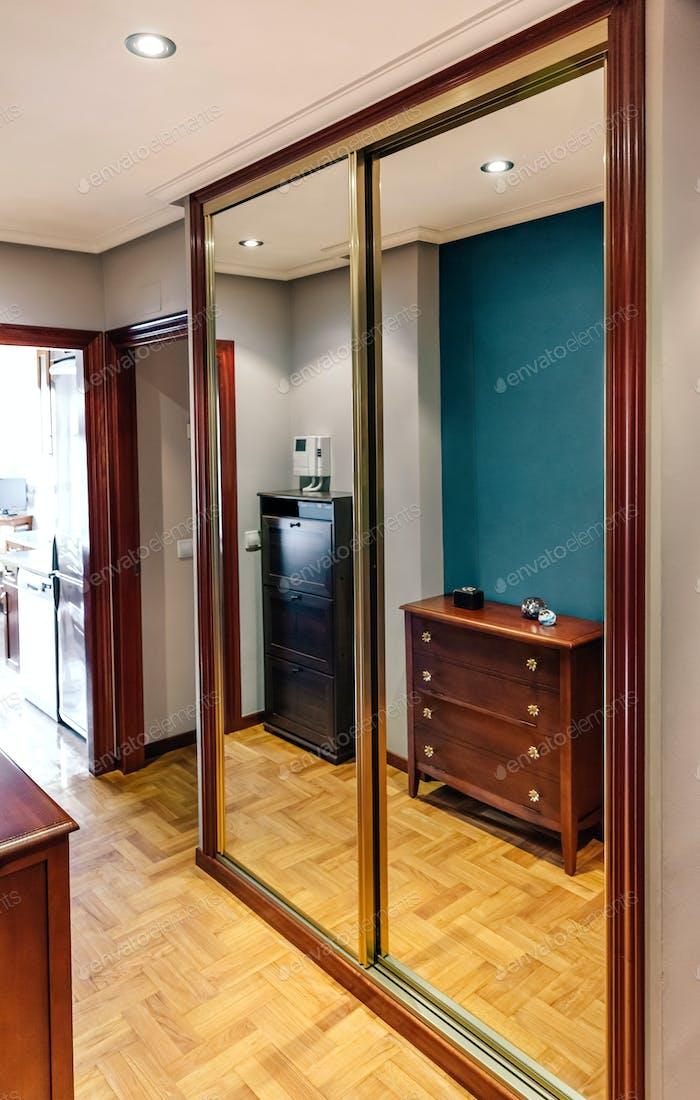 Built-in wardrobe with mirror doors