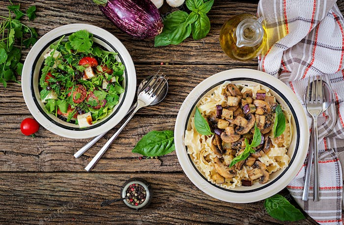 Vegetarian pasta with mushrooms and aubergines, eggplants and salad