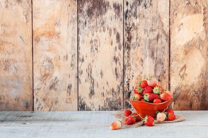 fresh strawberries on wooden