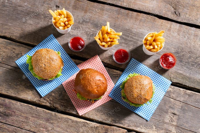 Fries with ketchup and burgers.