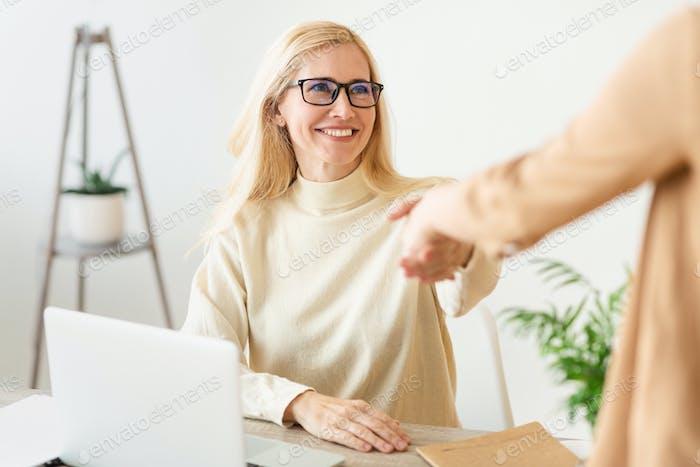 Confident woman job seeker applicant handshaking hr