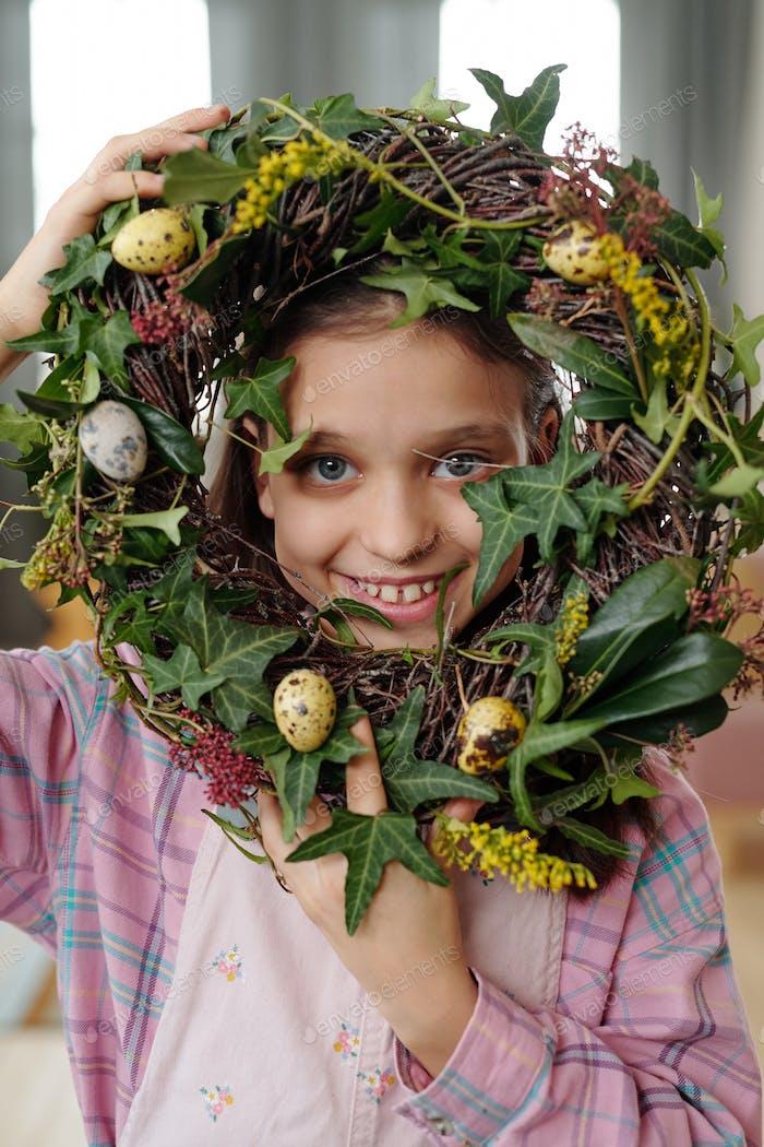 Little girl with flower wreath