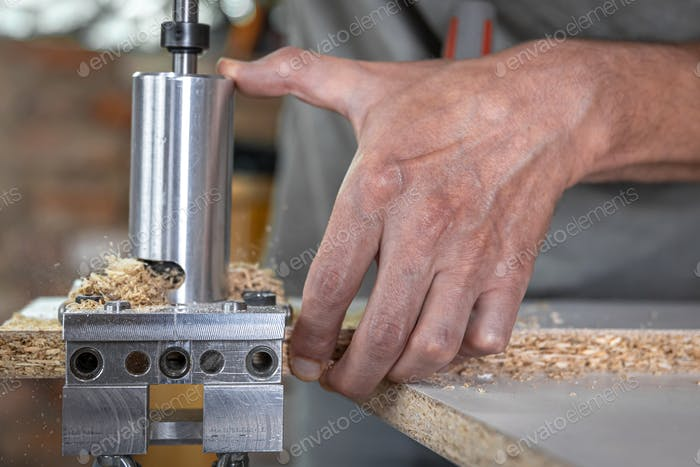 Professional carpenter working with wood and building tools.