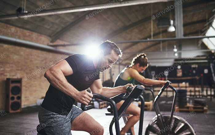 Sportsmen working out hard on cycling machines