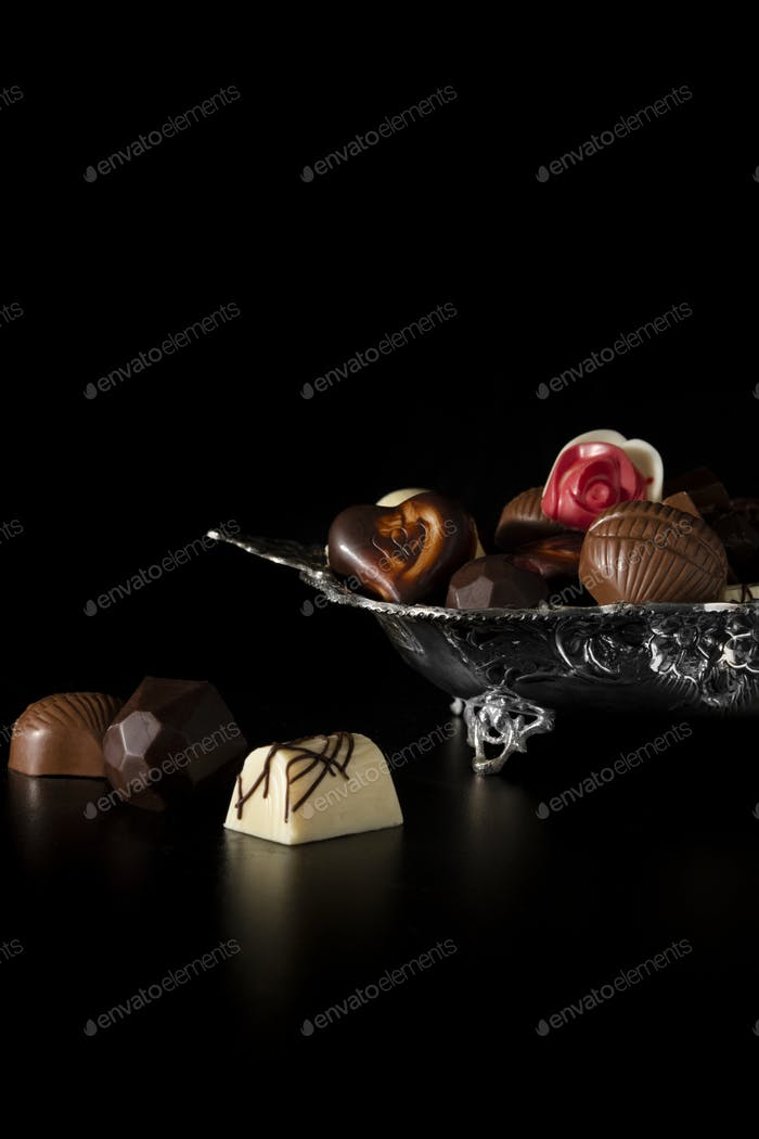 Different small chocolates in a silver plate
