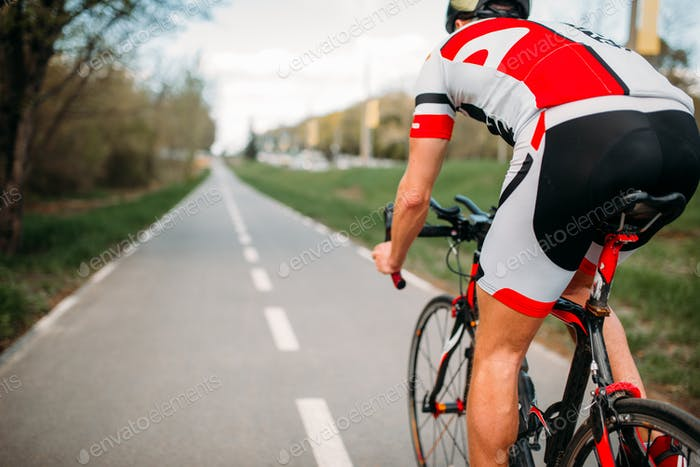Thumbnail for Cyclist in helmet and sportswear rides on bicycle