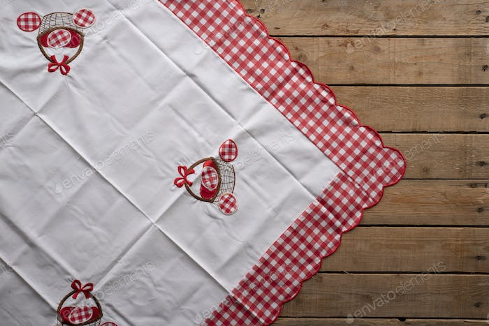 Easter tablecloth on an old rustic wooden table