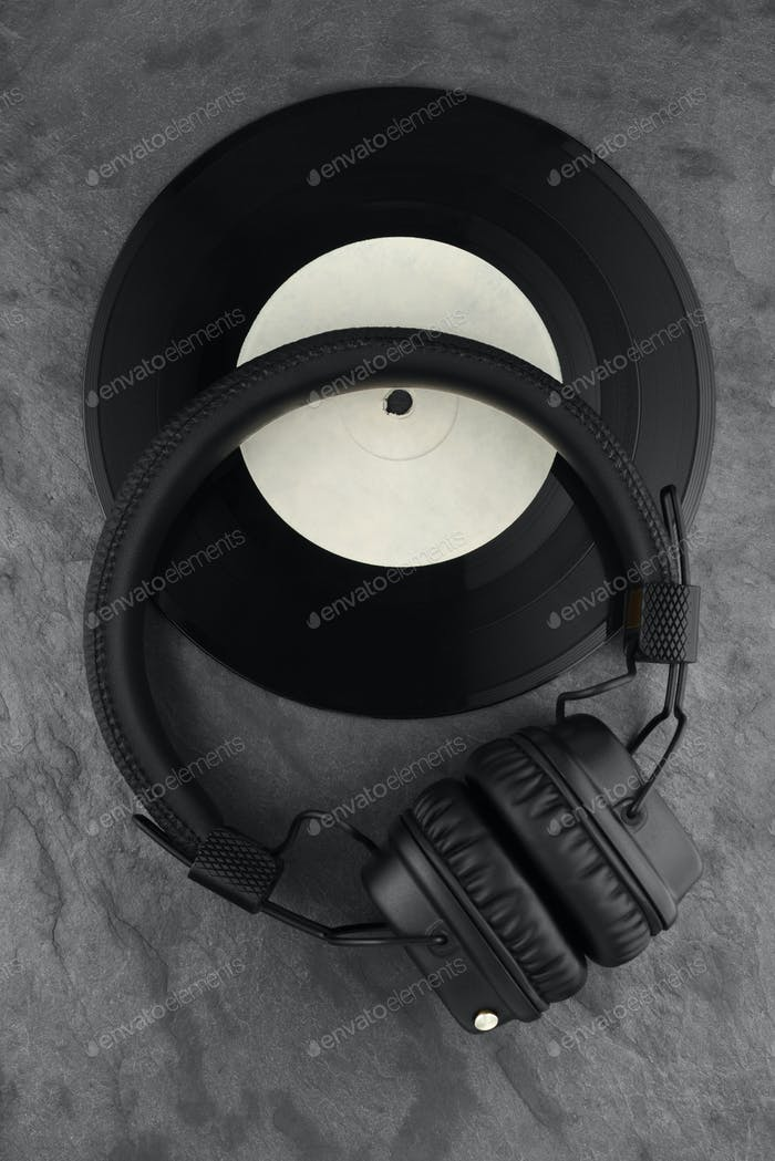 Headphones on vinyl record.