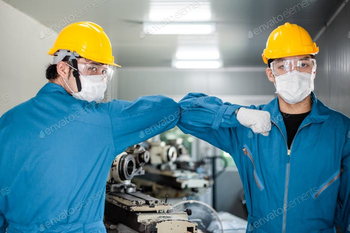 factory worker elbow bump greeting