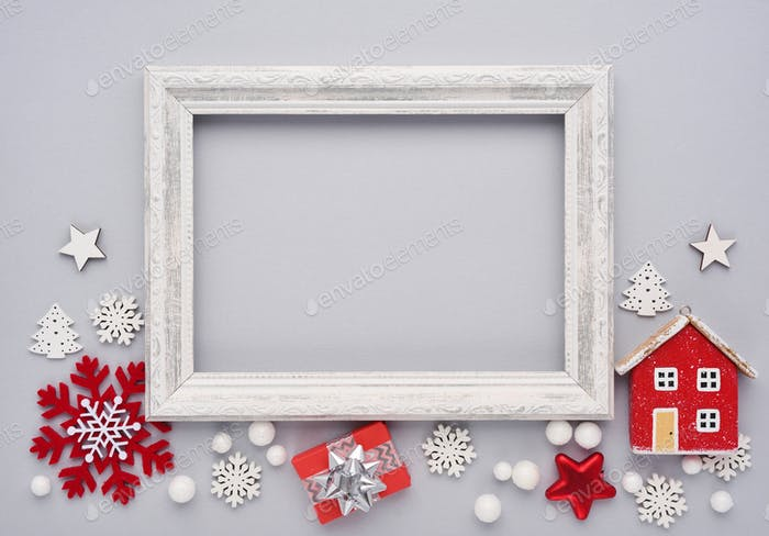 Christmas composition. Photo frame, christmas decorations on gray background