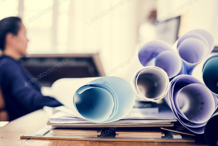Businesswoman working in office and a document