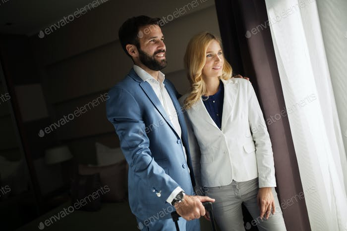 Picture of businessman and businesswoman in hotel room