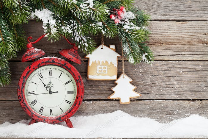 Christmas alarm clock and fir tree branch