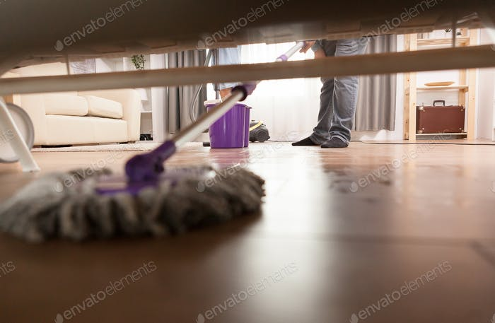 Cleaning dust under sofa