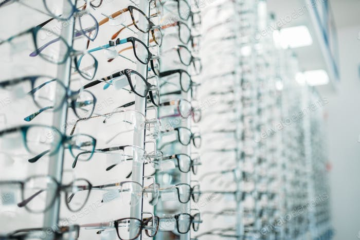 Eyeglasses and sunglasses showcase in optic shop