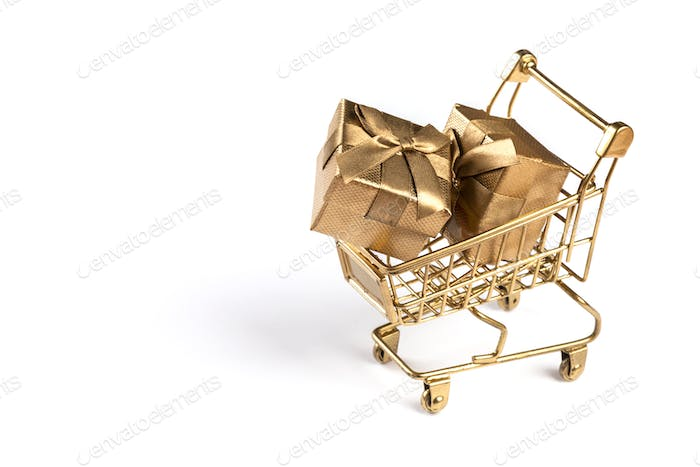 Shopping cart trolley basket gold color with gifts.