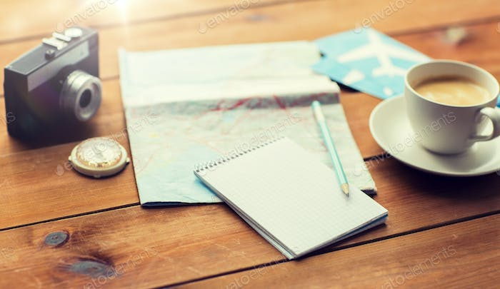 close up of notepad with map and travel tickets