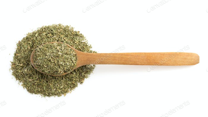 dried green spices and spoon