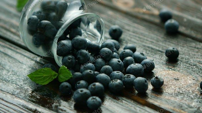 Blueberry scattering out of jug