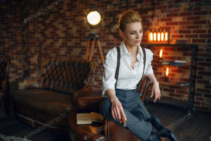 Business woman in strict clothes at the window