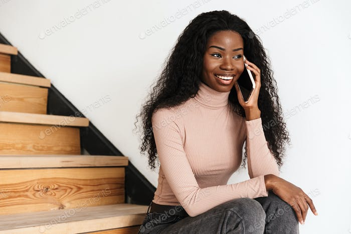 Cheery positive young african woman