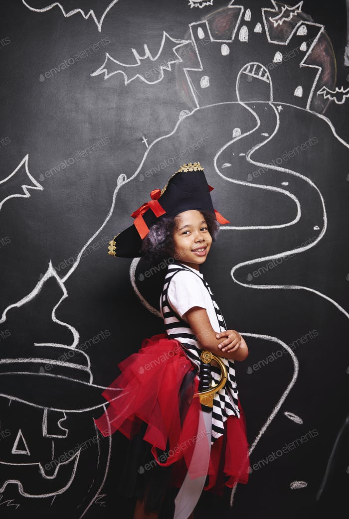 Mixed race girl in pirate costume