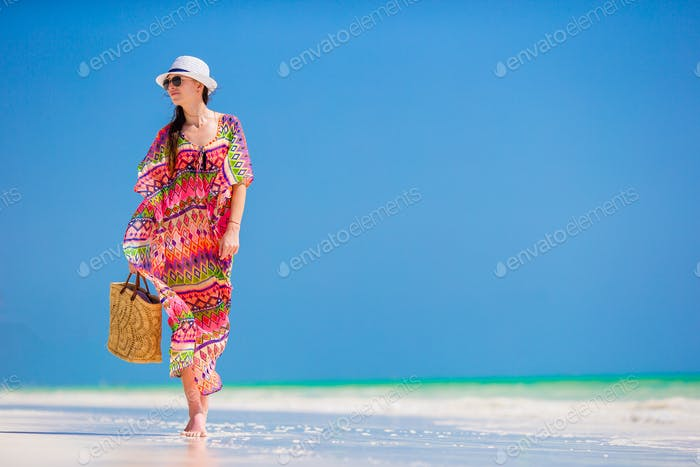 Young woman in hat during tropical beach vacation