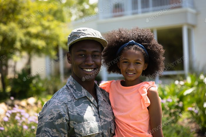 Portrait of soldier with daughter