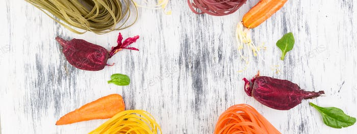 Banner of Colored Raw Vegetable Vegetarian Pasta.