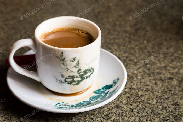 Traditional oriental Chinese coffee in vintage mug and saucer