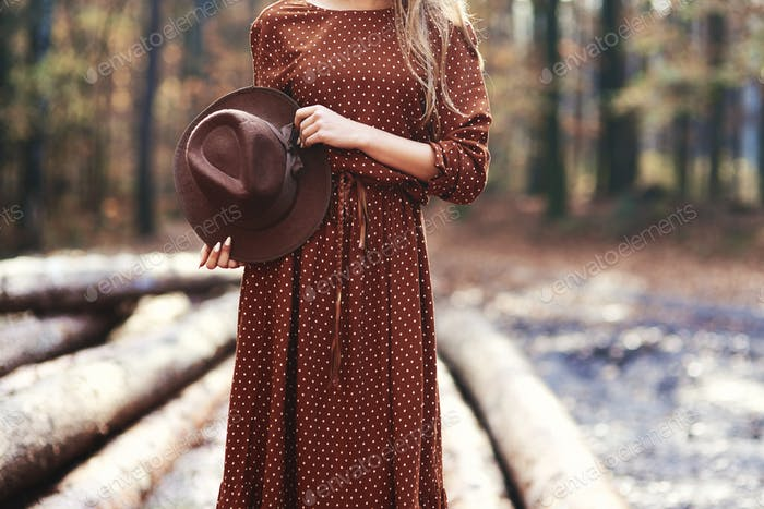 Gorgeous young woman in autumn forest