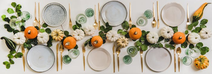 Fall table setting for celebration Autumn holiday with pumpkins