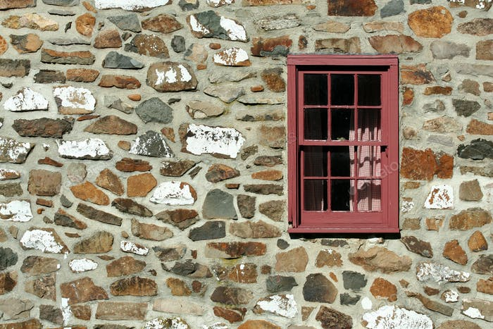 Old stone house with window