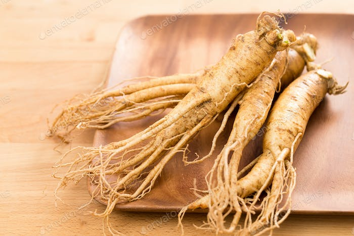 Fresh Ginseng on wooden plate