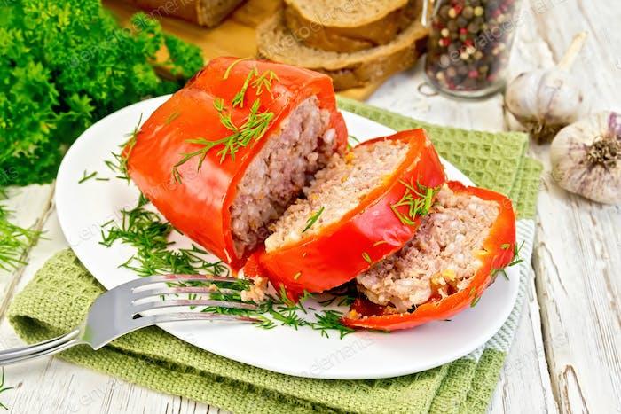 Pepper stuffed meat in plate on board