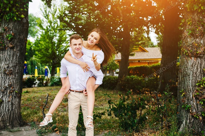 Young adult brunette man and woman in the park